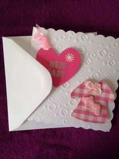 A personal favourite from my Etsy shop https://www.etsy.com/listing/233140654/new-baby-card-with-pink-heart-and-dress