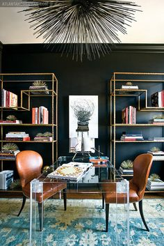 The repetition of sea urchins in the bookcases and the light fixture keeps your eyes moving around the space.