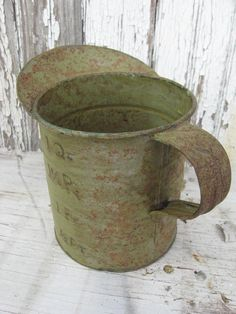A rusty, chipped measuring cup circa ?