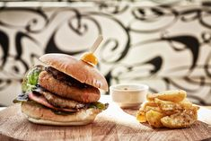 Blank angus burger with brioche bread, caramelized onions & homemade potatoes. Olympic Restaurant, Angus Burger, Brioche Bread, Executive Chef, Caramelized Onions, Salmon Burgers, Olympics, Potatoes, Homemade