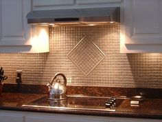 I am obsessing about backsplash designs right now. I have clear-varnished solid oak cabinets. I need a little spice under the cabinets, and I think a backsplash is the way to go. Look at this beautiful design...