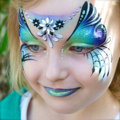 Adorable and really colorful jewel accented face painting by Pixies Face Painting,