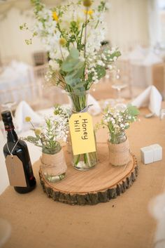 Family Farm Yellow Marquee Wedding Jar Flowers Log http://www.fayecornhillphotography.co.uk/ http://www.hotchocolates.co.uk http://www.blog.hotchocolates.co.uk http://www.evententertainmenthire.co.uk