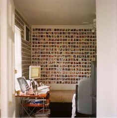 Print out pictures and put them all over the wall. You can also arrange them in a pattern (heart, star etc.)