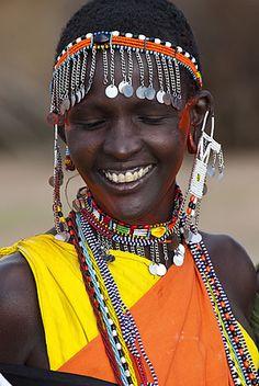 Africa | Masai women with colourful dress and beadwork. Kenya. | ©Gulin Photography