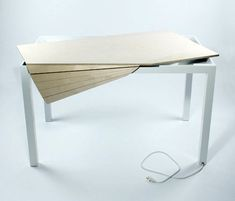 You know those desks that have the rolling tambour doors that slide open and closed to expose or hide the desk? Well, Brooklyn-based industrial designer Michael Bambino took that idea and flipped it on its head with his Tambour Table. It's a desk/computer table that looks like your average work table. Not so…