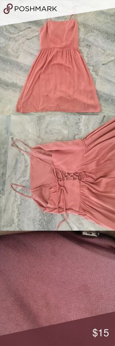Pink Dress Ink dress with crisscrossed back. It has very little stains mark in the front, 3rd picture. Forever 21 Dresses