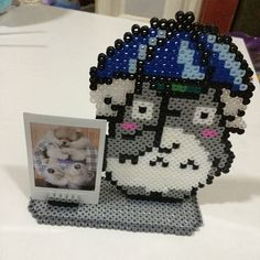 Totoro photo frame perler beads by secret_beads. I have never seen totoro before but this looks cool and this jus gives me so many ideas for frames I might want to make 3d Perler Bead, Perler Bead Templates, Hama Beads Design, Diy Perler Beads, Hama Beads Patterns, Beading Patterns, Totoro, Ghibli, Pixel Art