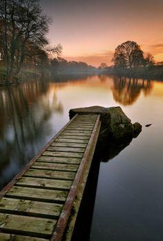 A dock watch the sun set