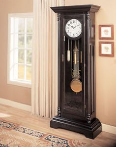 Traditional black painted grandfather clock