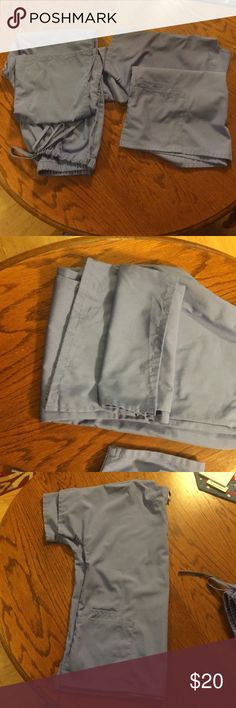 Ladies ceil blue scrub set. Size medium NWOT never worn. I bought these and they are too big for me. These are Cherokee brand top and bottom. Pants are wider at bottom with the slit. The top is typical V neck with 2 large pockets. Cherokee Tops Tees - Short Sleeve