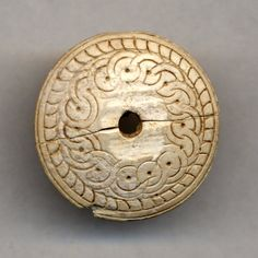 Ivory spindle whorl. Cyprus, 1340-1050BC, Late Cypriot IIC or Late Cypriot III. British Museum