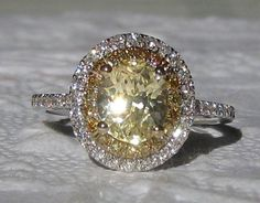 Yellow and white diamond halo style ring #engagement #wedding #love