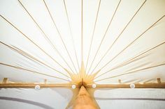 Traditional wooden pole sailcloth tent to hire for events and weddings in Kent and East Sussex. Tent Hire, Wooden Poles, Sailing Outfit, East Sussex, Tents, Ceiling Fan, Wedding Events, Traditional, Home Decor