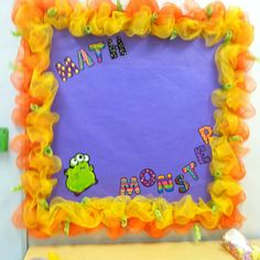 Use mesh as border! You can get most colors at hobby lobby. It is fun and very cute! Just staple to your bulletin board!