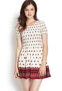 A tribal-inspired piece, this lightweight dress features a bordered geo print and smocked bodice....