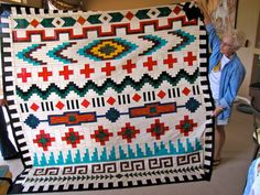 Looks like a beautiful Seminole (type) pieced quilt with Navajo (dine) inspired design. Love it.