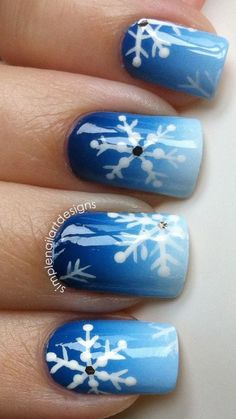 Stamp on snowflakes to your winter nails.