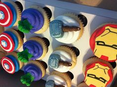 The avengers themed birthday cupcakes! Captain Americas shield, Thor's hammer, the hulks fist and ironman's mask!   Www.facebook.com/thecupcakers