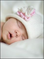 This sweet Rolled Brim Beanie with Flower knit baby hat pattern makes a great travel project!