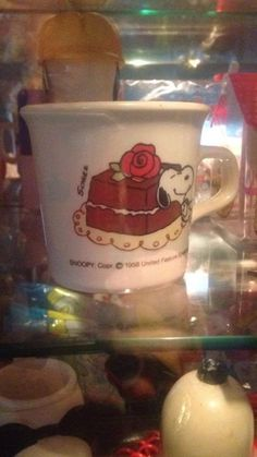 CollectPeanuts.com on Facebook - Starting the week out right! Donna shares two of her Snoopy mugs featuring Chocolate Cake and Cherry Pie.  Join the Snoopy Spotters! Post photos of your favorite Peanuts finds on the CollectPeanuts.com Facebook wall.