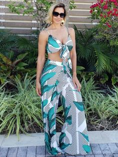 The flattering fit on our wrap pants is wonderful! The high rise fit will flatter any and every body type on these pants that have front slits! Wear this with the matching top! Model is wearing Medium. Wrap Pants, Body Types, Fashion Boutique, Medium, Fit, Model, How To Wear, Tops, Dresses