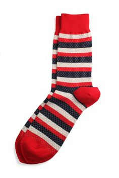 A pair of natty socks peaking out from under a guys pant legs is a great look, and instantly makes a simple outfit much more stylish. These Rookie Red, White & Blue Socks by Richer Poorer would be a good start to a guys fashionable sock collection   $9 on sale #mensholidaygifts #nattyguy #thenatty