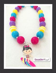 Our Surfer Girl Rainbow Bubblegum Bead Necklace with pink, teal, yellow and purple beads and featuring a rhinestone surfer girl pendant is just $18 including shipping (untracked) anywhere in Australia. More designs available at www.bubblegumroyal.com