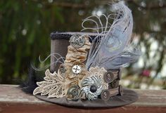 Steampunk Mini Top Hat - Alice in Wonderland - Party Top Hat - Steampunk Hat. $42.00, via Etsy.
