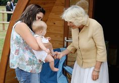 Camilla Parker Bowles Photos - Camilla, Duchess of Cornwall members of the armed forces families as she visits the Poppy Pod Village at the Tile Barn Outdoor Centre on July 26, 2016 in Brokenhurst, England. The Village stands on the site of a former First Word War Hospital and provides accomodation for service personnel and their families. - The Duchess Of Cornwall Visits Commonwealth War Graves & Opens Poppy Pod Village