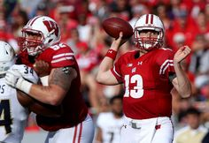 Bart Houston #13 of the Wisconsin Badgers throws a pass in the third quarter…
