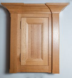 """*Moulding Monday* Flat pilasters with chamfers on either side of this Square Inset Frame cabinet with our Hudson 1"""" Thick door in Quarter Cut White Oak, natural finish. EK51 moulding is used as crown moulding, with the bottom frame extended with a chamfer for a light valance."""