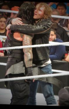 Brothers Dean Ambrose and Roman Reigns celebrate Roman Reigns win for the WWE World Heavyweight Championship