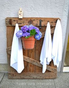 Wooden pallet towel hanger for pool... Or you could use ready made fence pieces from  hardware store - I need this!!