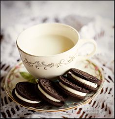 I like the milk in a fancy tea cup... I see this for some tea parties with CW in my future! And for a tea party birthday, this would be fun... although I'd have to dip the oreos in pink-food-colored-white-chocolate!