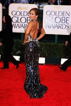Carrie Ann Inaba wearing a Lloyd Klein Couture Collection hand embroidered backless evening gown for the Golden Globes Awards Show.