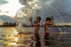 Thai boys indulge in the river near home,two boys in Wanonniwas Sakonnakhon ,Thailand | Thampitakkull Jakkree