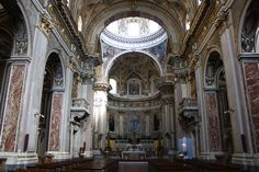 Santi Apostoli, Naples.  The interior features a Latin cross plan with a single nave covered by barrel vault with marble strip floor dating back to 1698.