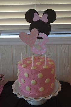 Minnie Mouse cake - pink buttercream icing with white choc melt spots