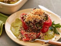 Get this all-star, easy-to-follow Turkey and Quinoa Stuffed Peppers recipe from Guy Fieri