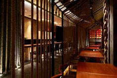 Ropes as dividers: Kemuri Shanghai Restaurant / Prism Design