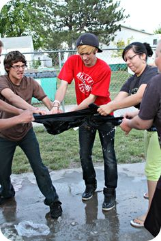 Summer Water Games: Team has to remove and melt a frozen T-shirt from a Ziploc Bag and then a designated team member has to put on the shirt. the first team to do this wins. Last day of VBS during water wars Youth Group Activities, Youth Games, Games For Kids, Fun Games, Team Games, Messy Games, Mutual Activities, Outdoor Water Activities, Outdoor Games