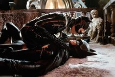 Batman Returns. By Tim Burton again. Michelle Peiffer is a spectacular Catwoman.
