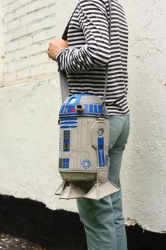 This bag is inspired by R2D2 from Star Wars movie. Made of fine quality wool felt and decorated with prints and embroidery, the bag is designed with