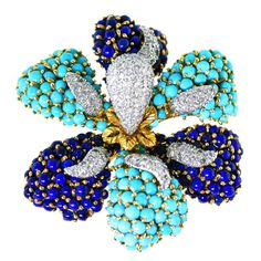 French Turquoise Lapis Lazuli Diamond Gold Flower Brooch   From a unique collection of vintage brooches at https://www.1stdibs.com/jewelry/brooches/brooches/