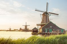 A summer sunset at Zaanse Schans. Worth visiting after-hours for a quiet & scenic evening. || Click on the photo to discover the most incredible destinations with us :)