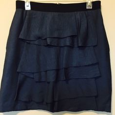 Navy blue ruffled BCBG skirt BCBGMaxAzria skirt with ruffles, back zipper, black waist band, and pockets. Fully lined. Rich shade of navy blue. Extremely comfortable and perfect for spring - goes well with a wide range of tops and can easily be dressed up or down. Excellent condition. Tank pictured available in separate listing. BCBGMaxAzria Skirts