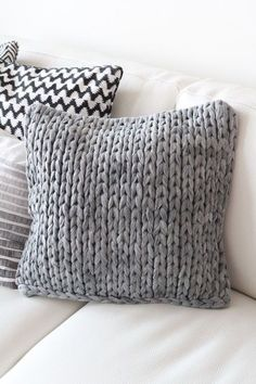 Chunky knit grey throw cushion