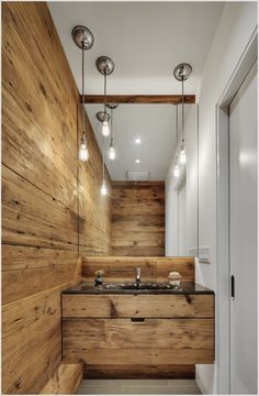 Powder-Room-Contemporary-Chicago-backlit-mirror-black-countertop-hanging-lightbulb-hanging-lights-integrated-sink-mirror-pocket-door-powder-room-re-cycled-re-used-wood-repurposed-material-sustainable-weathered-wood-id-2037.jpg (652×996)