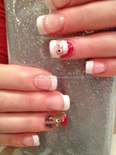 White polish tips with Santa and rudolf freehand nail art